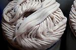 Alpaca wool is bundled like rope at an alpaca wool factory in El Alto, Bolivia.