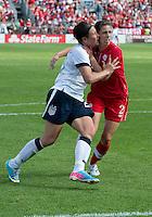02 June 2013: U.S. National Women's Team player Abby Wambach #20 battles with Canadian Women's player Emily Zurrer #2 during an international friendly soccer match between the U.S Women's National Team and the Canadian Women's National Team at BMO Field in Toronto, Ontario Canada.