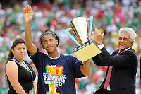 Giovani dos Santos of Mexico (MEX) celebrates earning the MVP trophy as Justino Compean, President of the Mexican Football Association applauds. Mexico (MEX) defeated the United States (USA) 5-0 during the finals of the CONCACAF Gold Cup at Giants Stadium in East Rutherford, NJ, on July 26, 2009.
