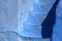 Blue painted steps in the medina or old town of Chefchaouen in the Rif mountains of North West Morocco. Chefchaouen was founded in 1471 by Moulay Ali Ben Moussa Ben Rashid El Alami to house the muslims expelled from Andalusia. It is famous for its blue painted houses, originated by the Jewish community, and is listed by UNESCO under the Intangible Cultural Heritage of Humanity. Picture by Manuel Cohen