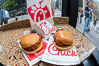 A classic Chick-Fil-A chicken sandwich and a Spicy Chicken sandwich in a Chick-Fil-A restaurant in New York on Saturday, May 14, 2016. New York Mayor Bill de Blasio recently called on New Yorkers to boycott the restaurant chain because of the religious beliefs of its president, Dan Cathy. The chain's popular two Manhattan operations see lines snaking out the door and has plans to open 12 more locations in New York. (© Richard B. Levine)