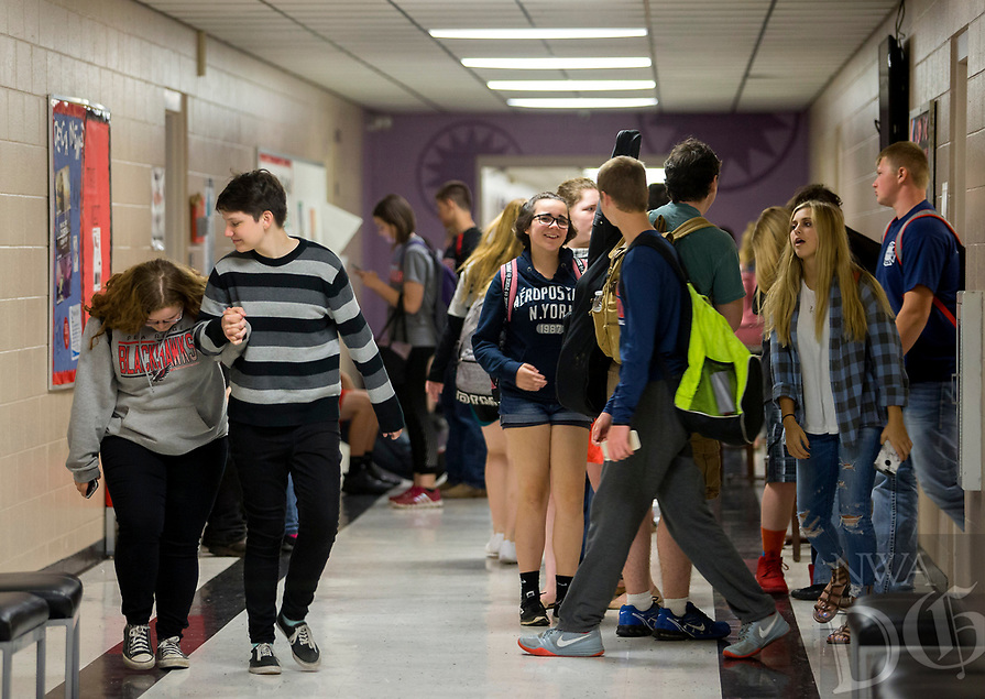 NWA Democrat-Gazette/JASON IVESTER<br /> Students walk through the halls Wednesday, May 17, 2017, at Pea Ridge High School. Voters in the district voted against a 5.1 millage increase.