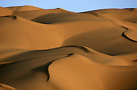 Sand dunes in the Taklamakan desert in Xinjiang province, China, on October 12, 2006. The Taklamakan Desert is a desert in Central Asia, in the Xinjiang Uyghur Autonomous Region of China. Photo by Lucas Schifres/Pictobank