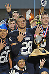 Drew Gibbs, surrounded by teammates with the trophy.  Photo for the Clarion by Michael Dinneen