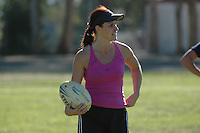"Saturday, 01/17/09:  San Diego, California, USA:  Ruth Oram smiles after scoring a try during a game of touch rugby at Torrey Highlands Park in Del Mar.  An informal group of players organised by Oram meets every Saturday morning at 11am for games.  The sport of Touch Rugby is a fast paced, exciting version of the full contact game that is gaining popularity in San Diego.  As the name suggests, the ""touch"" version of it is not a full contact game but more like flag football.  Pick-up games can be found most Saturdays in the Del Mar Park and on Sundays at the beach in Del Mar or Mission Beach."