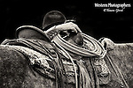 A black and white photo of a cowboy leaning on his horse and saddle. Cowboy Photos, riding,roping,horseback