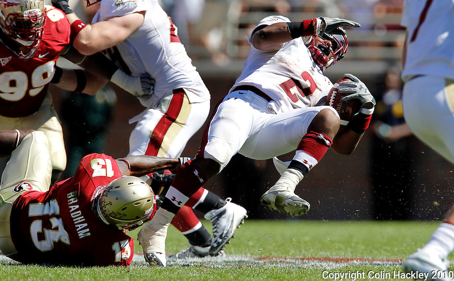 TALLAHASSEE, FL 10-FSU-BC 101610 FB10 CH-Florida State's Nigel Bradham, left, tackles Boston College's Montel Harris during second half action Saturday at Doak Campbell Stadium in Tallahassee. The Seminoles beat the Eagles 24-19. .COLIN HACKLEY PHOTO