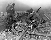 Commandoes of the 41st Royal British Marines plant demolition charges along railroad tracks of enemy supply line which they demolished during a commando raid, 8 miles south of Songjin, Korea.  April 10, 1951. (Navy)<br /> NARA FILE #:  080-G-428242<br /> WAR &amp; CONFLICT BOOK #:  1434