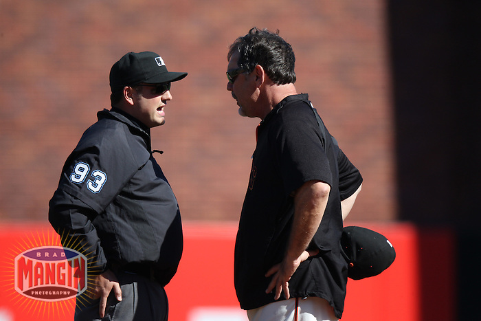 SAN FRANCISCO - AUGUST 28:  Second base umpire Dan Bellino argues with manager Bruce Bochy #15 of the San Francisco Giants during the game against the Houston Astros at AT&T Park on August 28, 2011 in San Francisco, California. Photo by Brad Mangin