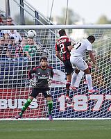 Olimpia forward Roger Rojas (21) and AC Milan defender Mattia De Sciglio (2) leap to head the ball in front of AC Milan goalkeeper Edoardo Pazzagli (60).  AC Milan defeated Olimpia 3-1 at Gillette Stadium on August 4, 2012.