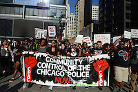 Demonstrators march across Washington Street to support a Citizens Police Accountability Council to provide civilian oversight of the Chicago Police Department in Chicago, Illinois on July 11, 2016.  The demonstration attracted a larger crowd on the heels of last week's racially charged police shootings captured on video of Alton Sterling in Baton Rouge, Louisiana and Philando Castile in the St. Paul suburb of Falcon Heights, Minnesota which was followed by a mass shooting of five police officers by Afghan War veteran Micah Johnson who supported radical and violent black nationalist ideology.