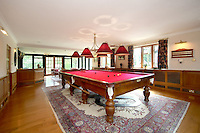 BNPS.co.uk (01202 558833).Pic: Savills/BNPS..***Please use full byline***..Games room...This quintessentially English property a short Aston Martin drive from the centre of London is leaving potential buyers shaken and stirred...Its the former home of James Bond star Roger Moore, where he lived when he shot his first three 007 movies in the 1970's...Sherwood House lies 20 miles west of central London in the village of Denham, Bucks...Moore's former home includes five bedrooms, a drawing room, study, library, gym, conservatory and of course a snooker room, wine cellar and swimming pool...The 11-acre property also has an annexe and guesthouse...Moore was the longest serving James Bond actor, spending 12 years in the role and featuring in seven Bond films from 1973 to 1985...Any potential buyers wanting to live the life of one of Her Majestys Secret Agents will have to find £4.5 million for the property.