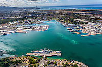 An aerial view of the Battleship Missouri Memorial at Ford Island, with Joint Base Pearl Harbor-Hickam beyond, O'ahu.