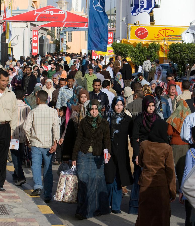 Tripoli, Libya, North Africa - Libyan Men, Women, Families at International Trade Fair.  Clothing Styles.