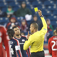 Yellow Card: New England Revolution midfielder Juan Carlos Toja (7). Referee: Ismail Elfath. In a Major League Soccer (MLS) match, the New England Revolution (blue) defeated Toronto FC (red), 2-0, at Gillette Stadium on May 25, 2013.