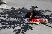 Israeli woman begging for money in the center of Jerusalem, July 02, 2013.  Photo by Oren Nahshon