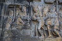 Borobudur, Java, Indonesia.  Bas-relief Stone Carving Depicting Wise Men Bringing Gifts to their Ruler.
