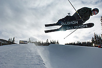 A skier sails over the rim of a half pipe at the Copper Mountain ski resort in Colorado, Thursday, Dec. 13, 2007. Copper Mountain hosts many features just for young skiers. (Kevin Moloney for the New York Times)
