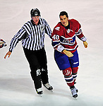 4 December 2008: Montreal Canadiens' center Maxim Lapierre is escorted to the pentalty box after receiving a fighting infraction against the New York Rangers at the Bell Centre in Montreal, Quebec, Canada. The Canadiens, celebrating their 100th season, played in the circa 1915-1916 uniforms for the evenings' Original Six matchup. The Canadiens defeated the Rangers 6-2. *****Editorial Use Only*****..Mandatory Photo Credit: Ed Wolfstein Photo