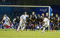 Guatemala's (16) Marco Pappa shoots a free kick over the USA's wall for a goal as the United States played Guatemala at Estadio Mateo Flores in Guatemala City, Guatemala in a World Cup Qualifier on Tue. June 12, 2012.
