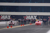Sept. 16, 2012; Concord, NC, USA: NHRA pro stock driver Shane Gray (right) crashes alongside Warren Johnson during the O'Reilly Auto Parts Nationals at zMax Dragway. Gray would be uninjured. Mandatory Credit: Mark J. Rebilas-