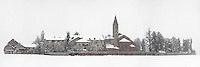 A wide panoramic view of the medieval abbey of Staffarda, probably the oldest and best conserved of Italy. Taken during a heavy snow fall at the beginning of March, this is stitched from four horizontal frames.
