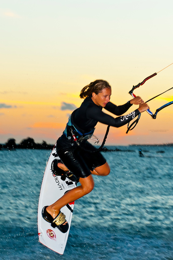 Kite surfing at sunset near the Meridien Hotel, Noumea, New Caledonia