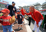 8 June 2008: Washington Nationals' Manager Manny Acta gives high-fives to Little League players prior to a game against the San Francisco Giants at Nationals Park in Washington, DC. The Nationals dropped the afternoon matchup to the Giants 6-3 in their third consecutive loss of the 4-game series. The Washington Nationals hosted the Little League event offering hundreds of regional players a chance to walk the field, and take in a big-league game at Nationals Park...Mandatory Photo Credit: Ed Wolfstein Photo