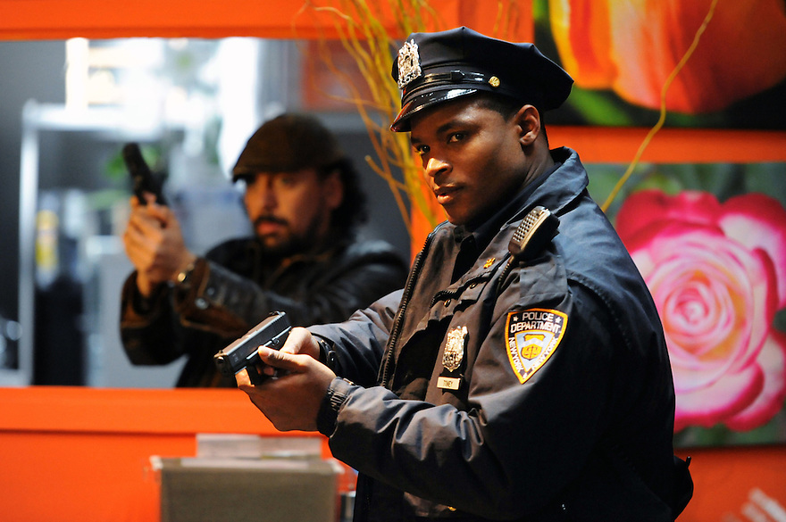 """Self Cleaning Oven""--Harold House Moore (right) and Felix Solis (left) star as cops, on NYC 22, Sunday, May 27 (10:00-11:00 PM, ET/PT) on the CBS Television Network. Photo: David M. Russell/CBS ??©2011 CBS Broadcasting, Inc. All Rights Reserved"