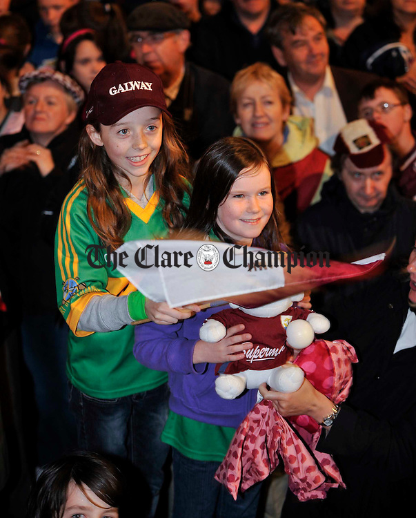 The girls cheer on their heroes at the Victorious Galway Minors All-Ireland homecoming at Gort. Photograph by John Kelly.