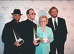 Bee Gees 1997 Maurice Gibb, Robin Gibb and Barry Gibb with their Mother at American Music Awards..© Chris Walter..