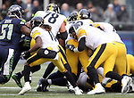Pittsburgh Steelers quarterback Ben Roethlisberger (7) runs for first down against the Seattle Seahawks at CenturyLink Field in Seattle, Washington on November 29, 2015.  The Seahawks beat the Steelers 39-30.      ©2015. Jim Bryant Photo. All Rights Reserved.