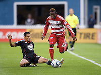 Andy Najar (14) of D.C. United tries to tackle the ball away from Fabian Castillo (15) of FC Dallas during the game at RFK Stadium in Washington, DC.  D.C. United tied FC Dallas, 0-0.