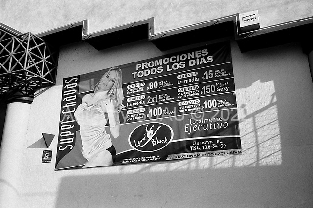 Culiacan, Sinaloa.Mexico.July 5, 2008..From January 1 to mid-July 2008 there have been 535 killings in Sinolao. Table dance bars surround Culiacan and are often visited by the drug traffickers.