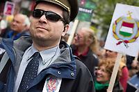 UNGARN, 22.04.2017, Budapest - VI. Bezirk. Die Spasspartei MKKP, &quot;Partei der doppelschwaenzigen Hunde&quot;, ruft zum Satire-Protest gegen die von der Fidesz-Regierung betriebene Putinisierung Ungarns. Es wird eine unerwartete Grossdemonstration mit tausenden Teilnehmern. -Der ortliche FSB-Leiter, hinter ihm das neue Staatswappen. | The MKKP funparty &quot;Two-tailed dog party&quot; calls for satiric protest against the Fidesz government's putinization of Hungary. The event turns into a large demonstration with thousands of participants. -The local FSB leader, behind him the new Hungarian coat of arms.<br /> &copy; Martin Fejer/EST&amp;OST