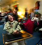 The Center for Medically Fragile Children at the Providence Medical Center holds their spring prom. Participant Ali Aleaziz laughs while being spun about to the music by student volunteer from Central Catholic High School....