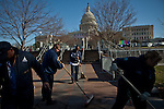 The Capitol grounds crew sweeps the steps of the Capitol in preparation for the presidential inauguration, January 20, 2013 in Washington, D.C.