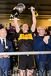 Hah handle of the cup breaks as Dr Crokes captain Johnny Buckley lifts it after defeating The Nire at Mallow on Sunday