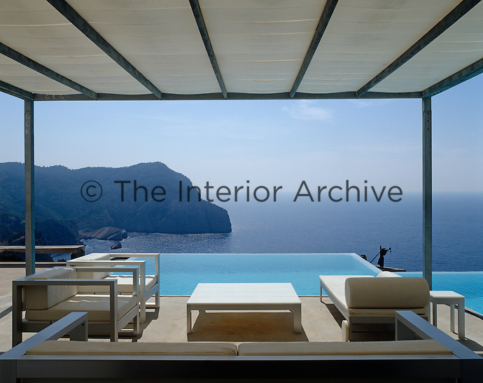 The terrace and infinity pool have an uprecedented view over the hills of Ibiza and the Mediterranean