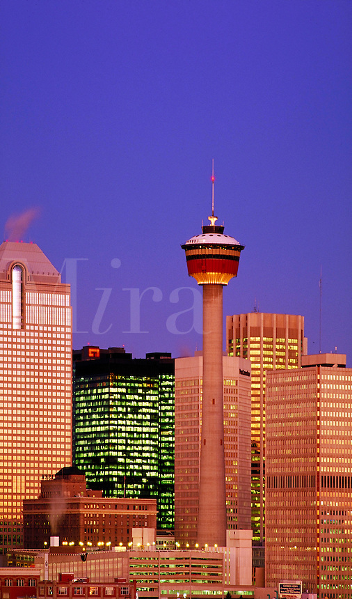 DOWNTOWN SKYLINE LOOKING NORTHWEST. CENTRAL BUSINESS DISTRICT, CALGARY TOWER, DUSK, SUNSET. CALGARY ALBERTA CANADA CITY CENTER.