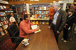 "Retired St. Louis Cardinals manager Tony La Russa signs copies of his book ""One Last Strike"" for Larry Little at Square Books in Oxford, Miss. on Thursday, November 29, 2012."