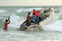 Fishermen push their boats into the Indian Ocean to go shark and lobster fishing early in the morning in the coastal village of Eyl. The town is a base for local pirates, who also use boats like this one. Piracy has fuelled the local economy.