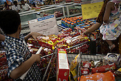 Shoppers are seen buying Japanese noodle products at a shopping mall in Mumbai, India. Photograph: Sanjit Das/Panos