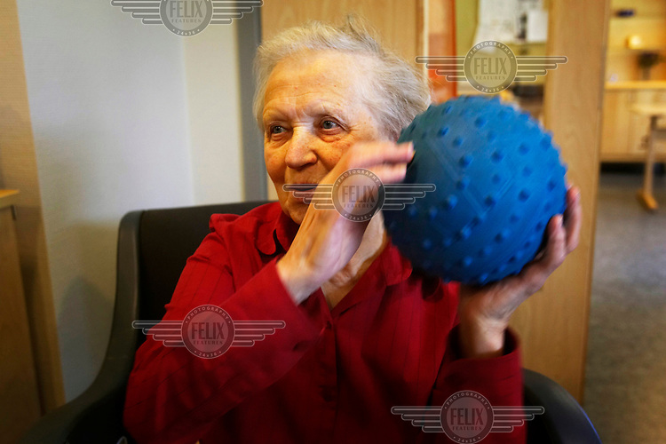Elderly people play catch with a ball at an old people's home. With a life expectancy of 74 years for women, Norway provides extensive services for the elderly to live and maintain their health.