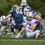 8 October 2016: Amherst College Purple & White Inside Linebacker John Callahan, a Sophomore from Bethlehem, PA, tackles Middlebury College Panther Wide Receiver Ryan Rizzo, a Senior from Needham, MA, at Alumni Stadium in Middlebury, Vermont. The Panthers edged out the Purple & While 27-26. Mandatory Credit: Ed Wolfstein Photo *** RAW (NEF) Image File Available ***