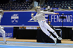 DURHAM, NC - FEBRUARY 26: Notre Dame's Jonah Shainberg (right) lunges at Duke's Pascual Di Tella (left) in the Men's Saber championship match. The Atlantic Coast Conference Fencing Championships were held on February, 26, 2017, at Cameron Indoor Stadium in Durham, NC.