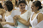 A sorority pledge smiles before the revealing of their bid cards, which determine the sorority a pledge will join.  The pledges convened at Memorial Coliseum during the 2011 sorority bid day event on Thursday, August 18, 2011. Photo by Brandon Goodwin | Staff