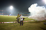 JAMES BOARDMAN / 07967642437.A local man fumigate the ground after the Champions League Twenty20 match between New South Wales Blues and Sussex Sharks at the Feroz Shah Kotla Stadium in New Delhi, October 11, 2009.