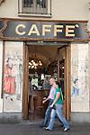 Two people passing outside Cafe Vittorio Veneto in Vittorio Veneto Square in Turin - Torino, Italy