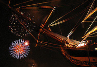 An Italian tall ship docked in Norfolk, Va., is celebrated against a backdrop of fireworks during OpSail 2000.